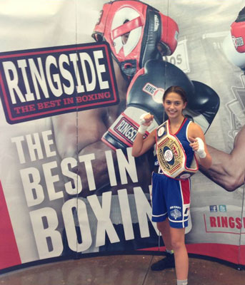Alexis poses at the 2015 Ringside World Championships with her friend China. Both 12 year old fighters are ranked number 1 in the world.
