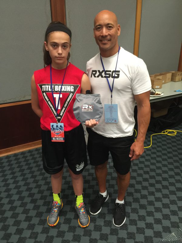 Junior Olympian Alexis Lavarine and David Newman owner of RX Smart Gear
