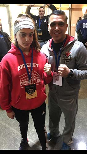 14 yr old Alexis Lavarine with friend USA Boxing Coach Rudy Silva from Elite Boxing Gym In Houston Texas..   At the 2016 USA National Qualifier in Kansas City, Missouri